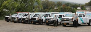 Masters Pest Control - Row of Employees and Trucks
