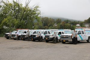 row of masters pest control workers and trucks